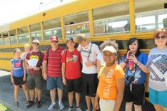 Group of Kids in Front of Bus in the Summer